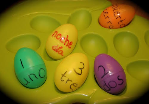 Use plastic eggs to play Spanish games for kids.